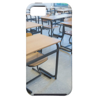Rows of tables and chairs in classroom iPhone 5 covers