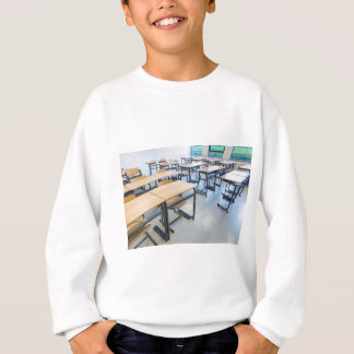 Rows of tables and chairs in classroom sweatshirt