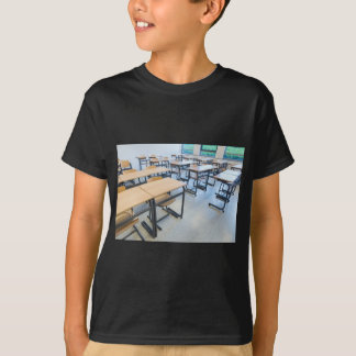 Rows of tables and chairs in classroom T-Shirt