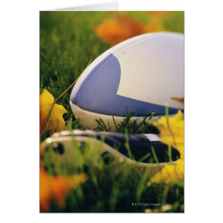 Rugby ball and shoe on lawn in autumn card