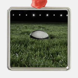 Rugby ball sitting on the grass pitch metal ornament