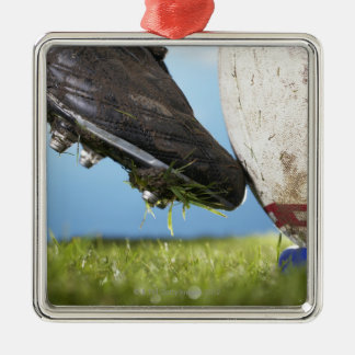 Rugby player kicking ball off tee, close up of Silver-Colored square ornament