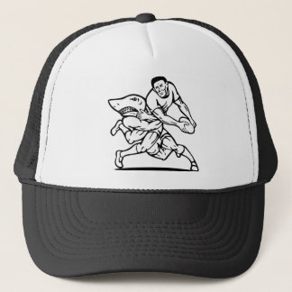 rugby player passing ball tackled by shark trucker hat