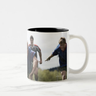 Rugby player scoring jumping on groud with ball Two-Tone coffee mug