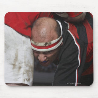 Rugby player tacking opponent, mid section mouse pad