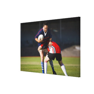 Rugby player tackling another canvas prints