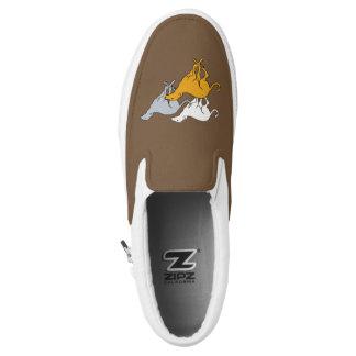 Running three Slip-On sneakers