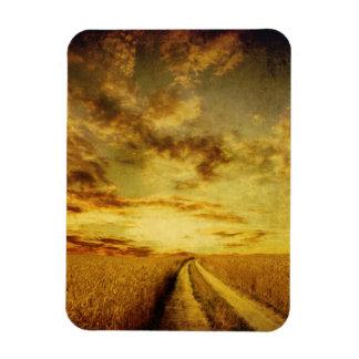 Rural dirt road through the field rectangular photo magnet