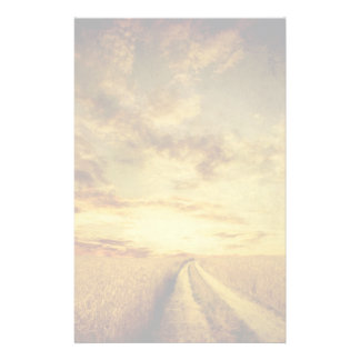 Rural dirt road through the field stationery