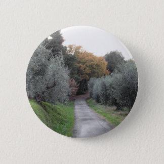 Rural landscape with asphalt road in the autumn 2 inch round button