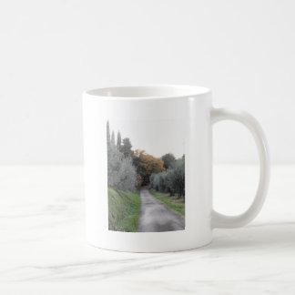 Rural landscape with asphalt road in the autumn coffee mug