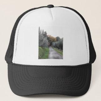 Rural landscape with asphalt road in the autumn trucker hat