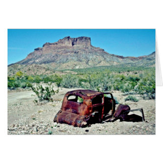 Rusted Antique Car In Front Of Butte Card