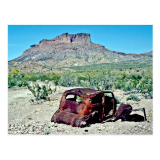 Rusted Antique Car In Front Of Butte Postcard