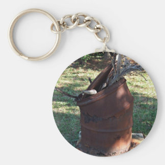 Rusted garbage can in grassy landscape basic round button keychain