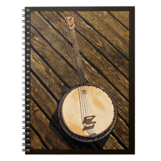 Rustic Banjo Music Instrument on Wood Notebook