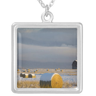 Rustic barn and hay bales after a fresh snow 3 silver plated necklace