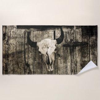 Rustic buffalo skull with horns against barn beach towel