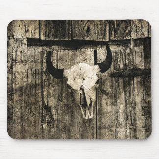 Rustic buffalo skull with horns against barn mouse pad