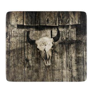 Rustic buffalo skull with horns on a barn cutting board