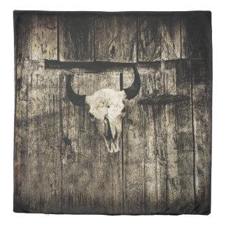 Rustic buffalo skull with horns on a barn duvet cover