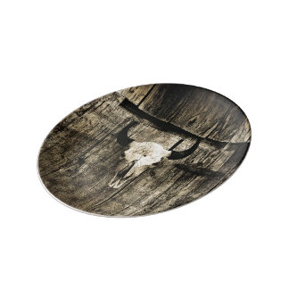 Rustic buffalo skull with horns on a barn plate
