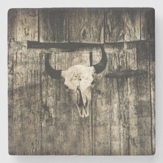 Rustic buffalo skull with horns on a barn stone coaster
