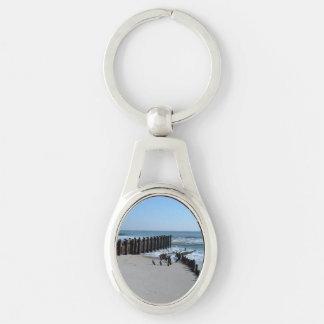 Rustic Bulkhead on Beach Silver-Colored Oval Keychain