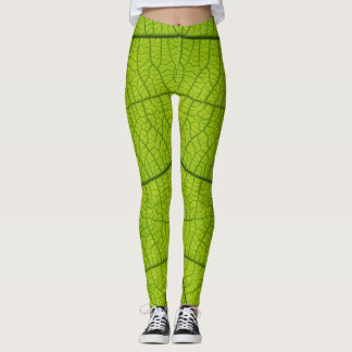 Rustic leggings print with green leaf close up