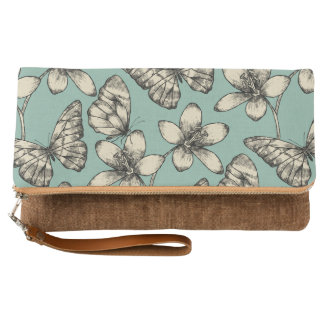 Rustic vintage butterfly and flowers on turquoise clutch