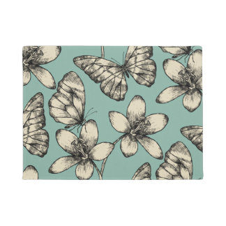 Rustic vintage butterfly and flowers on turquoise doormat