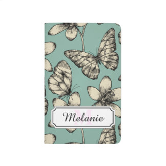 Rustic vintage butterfly and flowers on turquoise journal