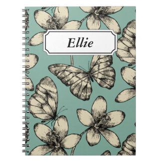 Rustic vintage butterfly and flowers on turquoise notebook