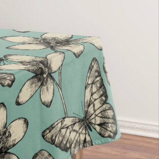 Rustic vintage butterfly and flowers on turquoise tablecloth