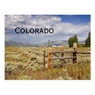 rustic wood fence by a prairie in Colorado Postcard