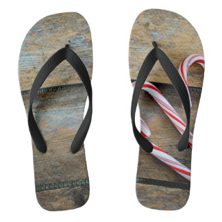 Rustic Wood with Christmas Candy Canes Flip Flops