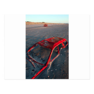 Rusty car wreck buried in sand on Waitarere Beach Postcard