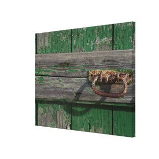 Rusty Door Handle On Green Door Canvas Print