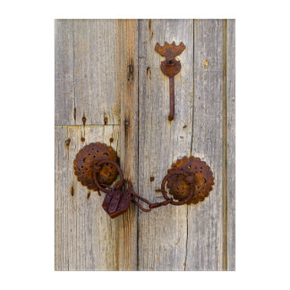 Rusty vintage old iron padlock on a wooden door .- acrylic wall art