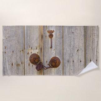 "Rusty vintage old iron padlock on a wooden door """" beach towel"