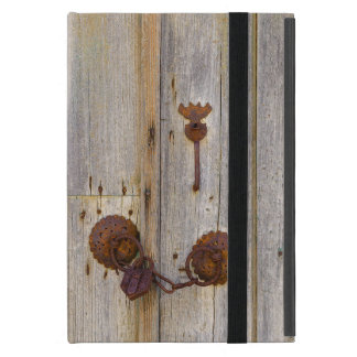 Rusty vintage old iron padlock on a wooden door .. iPad mini case