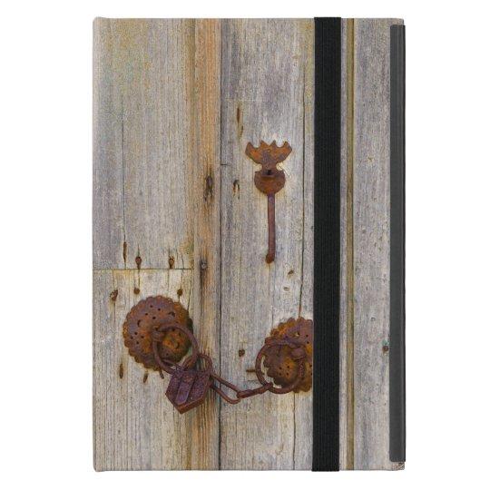 Rusty vintage old iron padlock on a wooden door .. iPad mini case