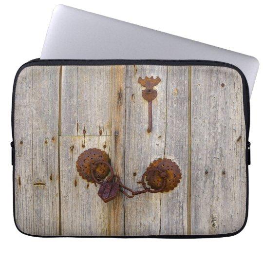 Rusty vintage old iron padlock on a wooden door -. laptop sleeve