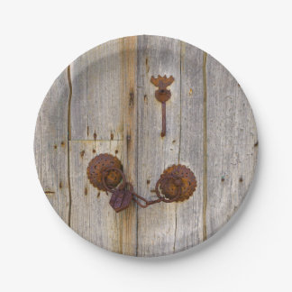 Rusty vintage old iron padlock on a wooden door // paper plate
