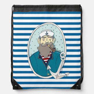 Sac bleu et blanc de capitaine et d'ancre de sac à dos