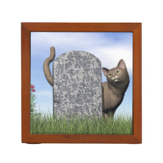 Sad cat near tombstone desk organizer