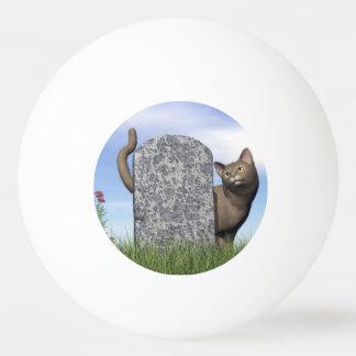 Sad cat near tombstone ping pong ball