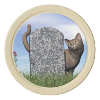 Sad cat near tombstone poker chips