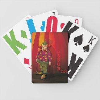 Sad clown playing cards