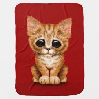 Sad Cute Orange Tabby Kitten Cat on Red Baby Blanket